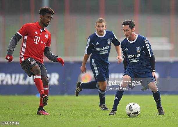 Kingsley Coman of FC Bayern Muenchen challenges Mirko Gerhard and Markus Reifer of the Paulaner Soccer Team during the Paulaner Fan Dream Bavarian...