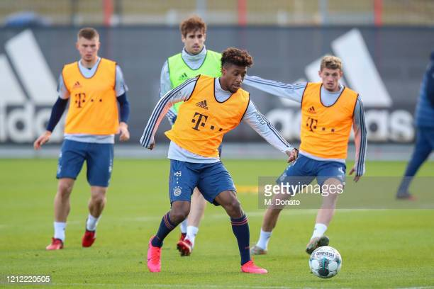 Kingsley Coman of FC Bayern Muenchen eyes the ball during a training session at Saebener Strasse training ground on March 13 2020 in Munich Germany