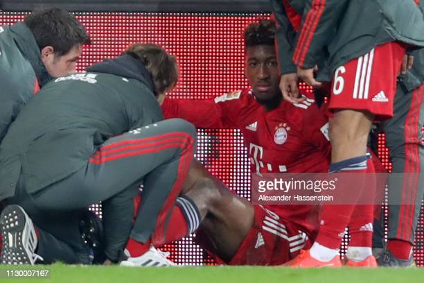 Kingsley Coman of FC Bayern Muenchen leaves the field after getting injured during the Bundesliga match between FC Augsburg and FC Bayern Muenchen at...