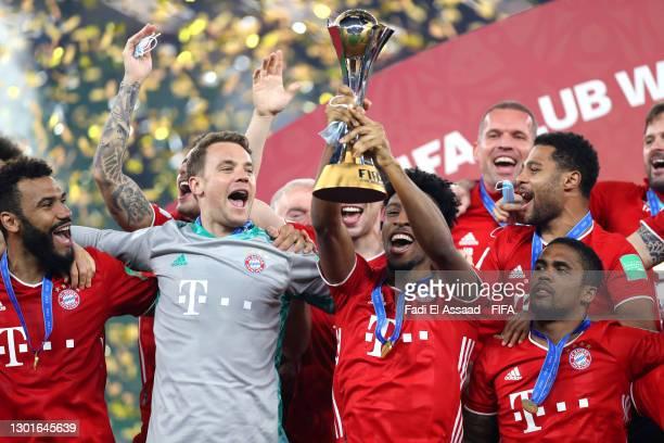 Kingsley Coman of FC Bayern Muenchen lifts the FIFA Club World Cup Qatar 2020 trophy as FC Bayern Muenchen celebrate after winning the FIFA Club...