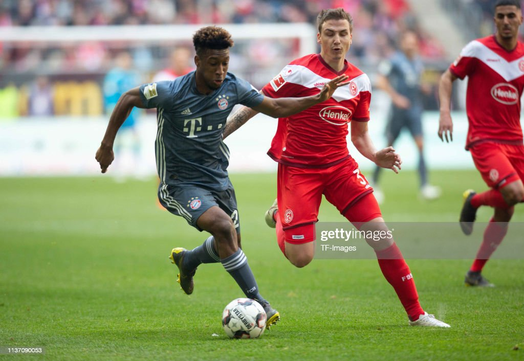 Kingsley Coman of FC Bayern Muenchen Marcel Sobottka of Fortuna Duesseldorf battle for the ball during the Bundesliga match between Fortuna...