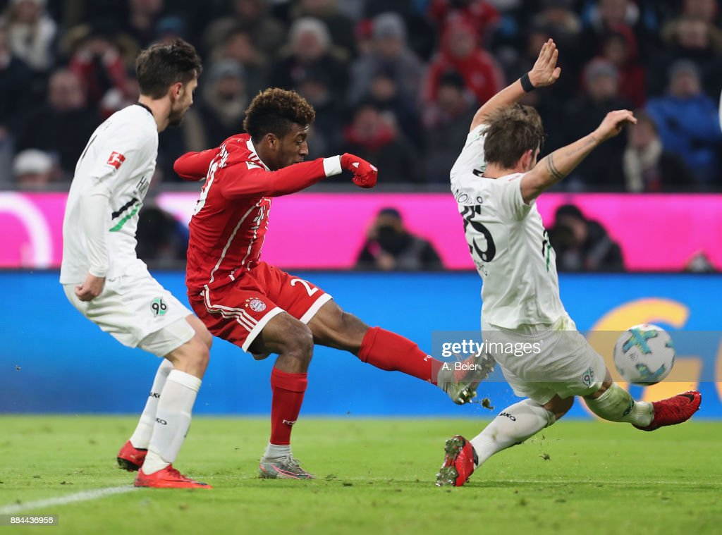 Kingsley Coman (C) of FC Bayern Muenchen scores his first goal against Julian Korb (L) and Oliver Sorg of Hannover 96 during the Bundesliga match between FC Bayern Muenchen and Hannover 96 at Allianz Arena on December 2, 2017 in Munich, Germany.