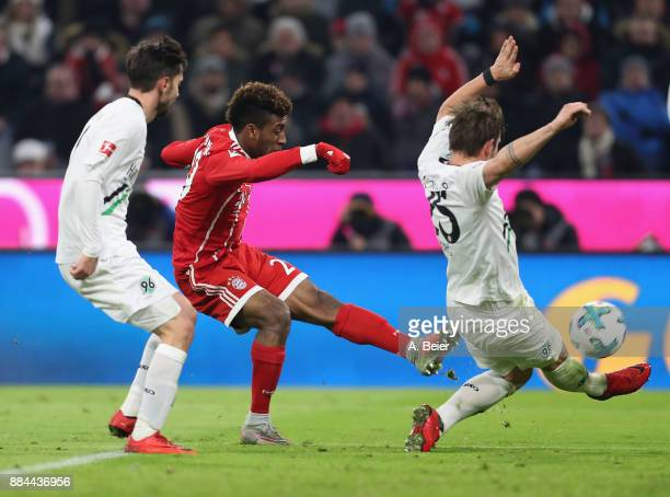 Kingsley Coman of FC Bayern Muenchen scores his first goal against Julian Korb and Oliver Sorg of Hannover 96 during the Bundesliga match between FC...