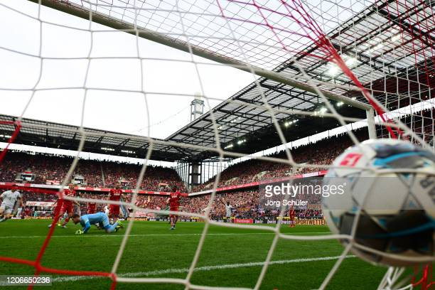 Kingsley Coman of FC Bayern Muenchen scores his sides second goal during the Bundesliga match between 1. FC Koeln and FC Bayern Muenchen at...