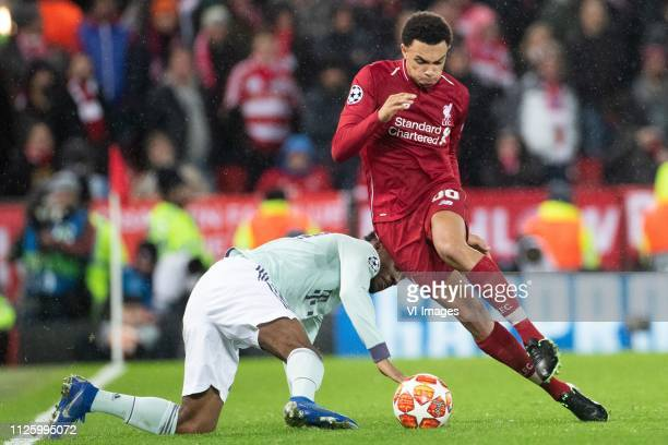 Kingsley Coman of FC Bayern Munchen Trent Alexander Arnold of Liverpool FC during the UEFA Champions League round of 16 match between Liverpool FC...