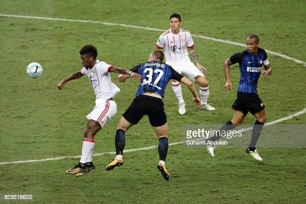 Kingsley Coman of FC Bayern Munich and Milan Skriniar of FC Internazionale challenge for the ball during the International Champions Cup match...