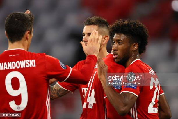 Kingsley Coman of FC Bayern Munich celebrates with teammates after scoring his sides first goal during the UEFA Champions League Group A stage match...