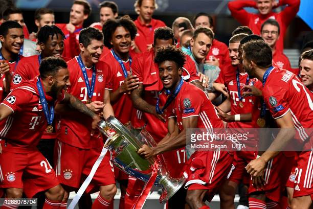 Kingsley Coman of FC Bayern Munich celebrates with the UEFA Champions League Trophy following his team's victory in the UEFA Champions League Final...
