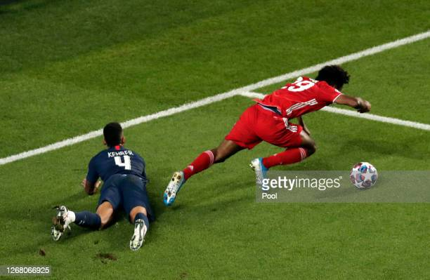Kingsley Coman of FC Bayern Munich is brought down by Thilo Kehrer of Paris Saint-Germain, in an incident that was then taken to VAR, but no penalty...