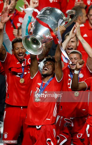 Kingsley Coman of FC Bayern Munich lifts the UEFA Champions League Trophy following his team's victory in the UEFA Champions League Final match...