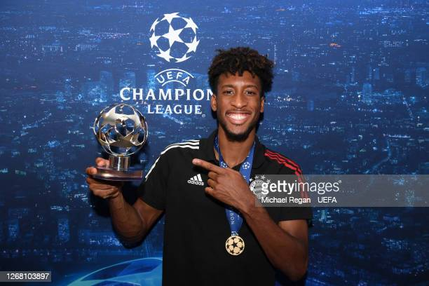 Kingsley Coman of FC Bayern Munich poses with the UEFA Champions League Man of the Match Trophy following the UEFA Champions League Final match...