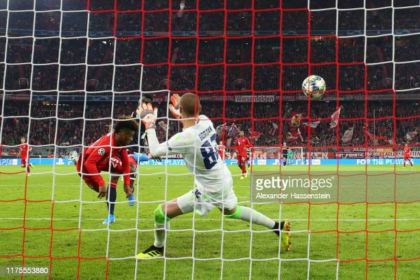 Kingsley Coman of FC Bayern Munich scores his team's first goal during the UEFA Champions League group B match between Bayern Muenchen and Crvena...