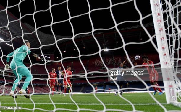 Kingsley Coman of FC Bayern Munich scores his team's first goal during the past Keylor Navas of Paris Saint-Germain UEFA Champions League Final match...