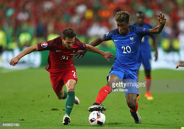 Kingsley Coman of France and Cedric Soares of Portugal compete for the ball during the UEFA EURO 2016 Final match between Portugal and France at...