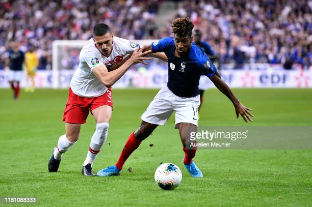 Kingsley Coman of France and Merih Demiral of Turkey fight for the ball during the UEFA Euro 2020 qualifier between France and Turkey on October 14...