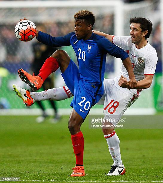 Kingsley Coman of France battles for the ball with Yuri Zhirkov of Russia during the International Friendly match between France and Russia held at...