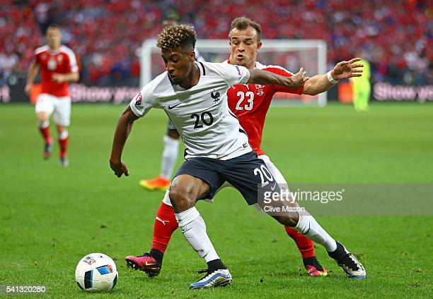 Kingsley Coman of France controls the ball under pressure of Xherdan Shaqiri of Switzerland during the UEFA EURO 2016 Group A match between...