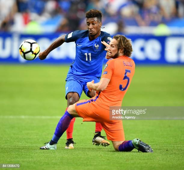Kingsley Coman of France in action against Daley Blind of Netherlands during the FIFA World Cup 2018 qualifying Group A match between France and...