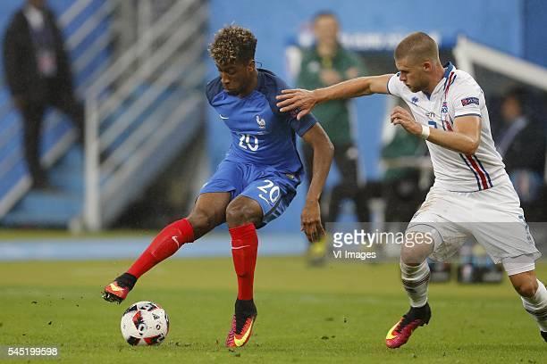 Kingsley Coman of France Johann Berg Gudmundsson of Iceland during the UEFA EURO 2016 quarter final match between France and Iceland on July 3 2016...