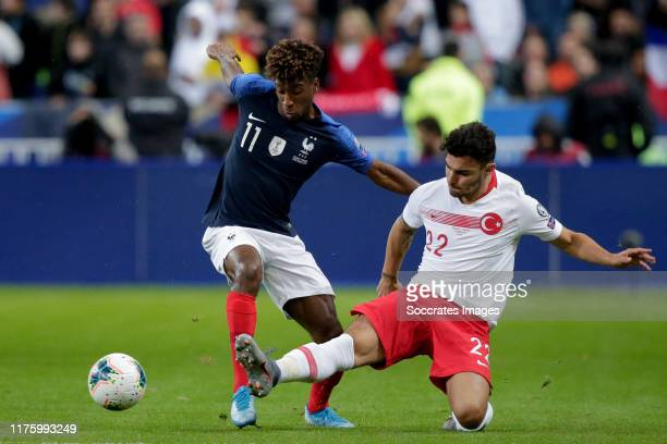 Kingsley Coman of France, Kaan Ayhan of Turkey during the EURO Qualifier match between France v Turkey at the Stade de France on October 14, 2019 in...