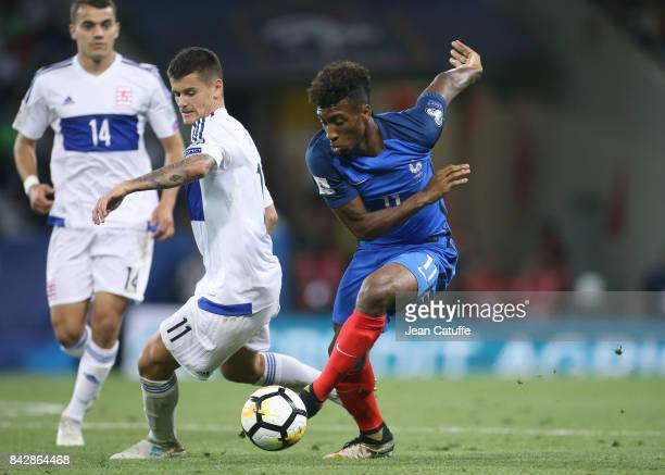 Kingsley Coman of France Olivier Thill of Luxembourg during the FIFA 2018 World Cup Qualifier between France and Luxembourg at the Stadium on...
