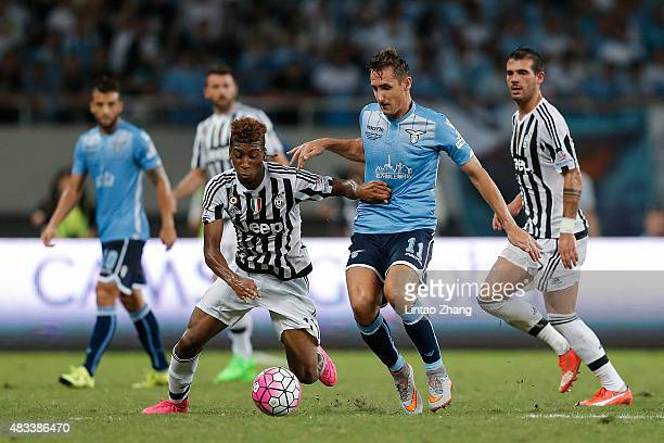 Kingsley Coman of Juventus FC contests the ball against Miroslav Klose of Lazio during the Italian Super Cup final football match between Juventus...