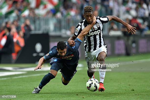 Kingsley Coman of Juventus FC tussles for possession with Miguel Angel Britos of SSC Napoli during the Serie A match between Juventus FC and SSC...