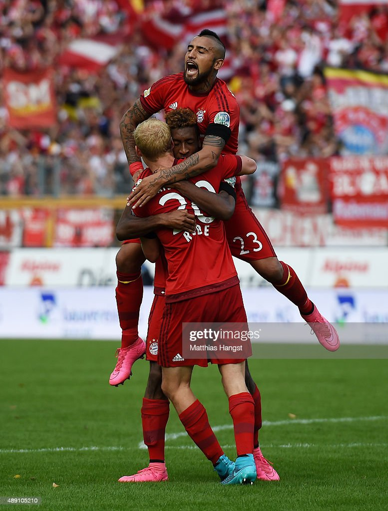 Kingsley Coman of Muenchen celebrates with his team-mates Sebastian Rode of Muenchen and Arturo Vidal of Muenchen after scoring his team's second goal during the Bundesliga match between SV Darmstadt 98 and FC Bayern Muenchen at Merck-Stadion am Boellenfalltor on September 19, 2015 in Darmstadt, Germany.
