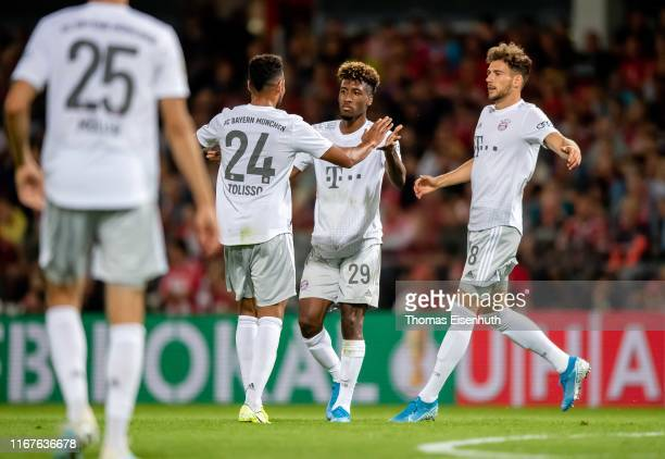 Kingsley Coman of Muenchen celebrates with Leon Goretzka and Corentin Tolisso after scoring his team's second goal during the DFB Cup first round...