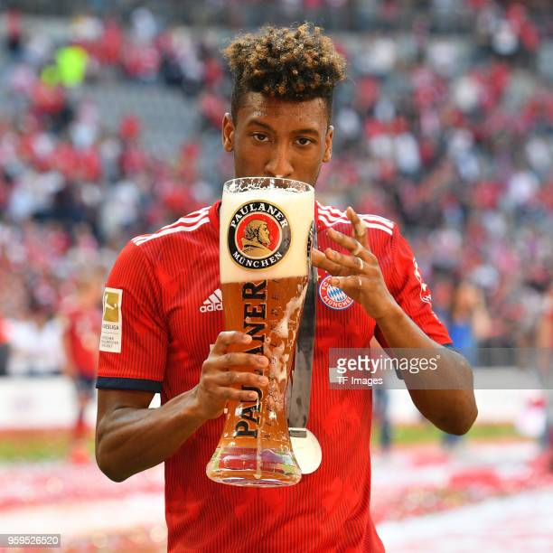 Kingsley Coman of Muenchen drinks beer after the Bundesliga match between FC Bayern Muenchen and VfB Stuttgart at Allianz Arena on May 12 2018 in...