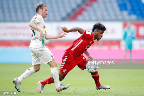 Kingsley Coman of Muenchen is challenged by Tony Jantschke of Moenchengladbach during the Bundesliga match between FC Bayern Muenchen and Borussia...