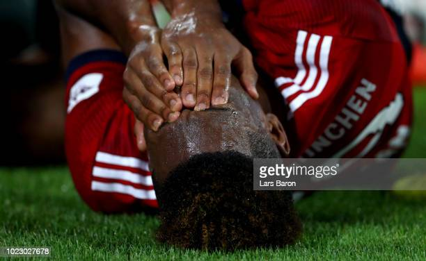 Kingsley Coman of Muenchen lies injured on the pitch during the Bundesliga match between FC Bayern Muenchen and TSG 1899 Hoffenheim at Allianz Arena...