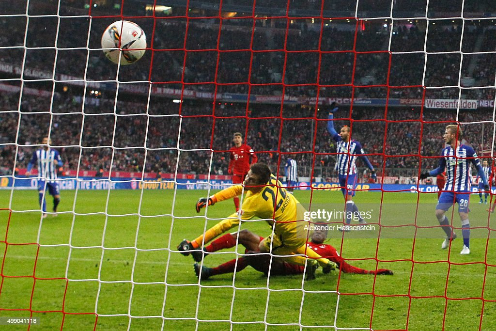 Kingsley Coman of Muenchen scres the second team goal against Rune Jarstein, keeper of Berlin during the Bundesliga match between FC Bayern Muenchen and Herha BSC Berlin at Allianz Arena on November 28, 2015 in Munich, Germany.
