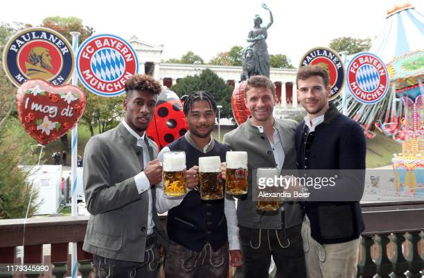 Kingsley Coman, Serge Gnabry, Thomas Mueller and Leon Goretzka of FC Bayern Muenchen attend the Oktoberfest at Kaefer Wiesenschaenke tent at...