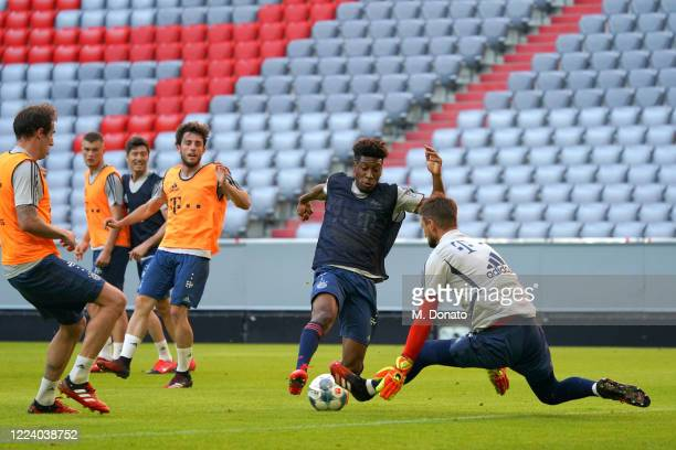 Kingsley Coman tries to score against goalkeeper Sven Ulreich during a training session of FC Bayern Muenchen at Allianz Arena on May 10, 2020 in...