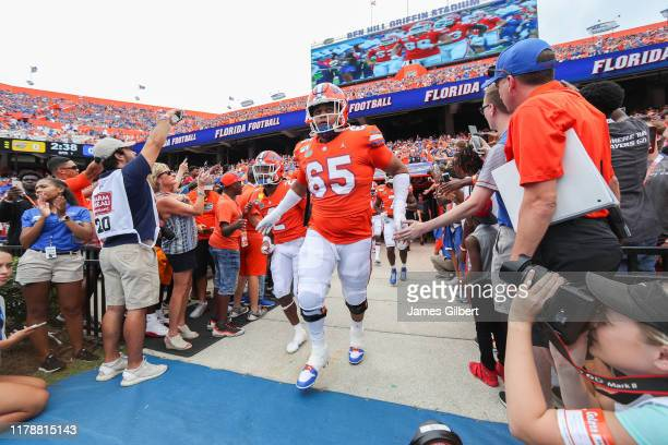 Kingsley Eguakun of the Florida Gators and teammates enter the field before the start of a game against the Towson Tigers at Ben Hill Griffin Stadium...