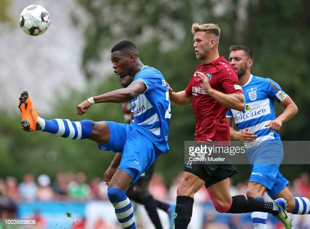 Kingsley Ehizibue of PEC Zwolle and Niclas Fuellkrug of Hannover battle for the ball during the preseason friendly match between Hannover 96 and PEC...