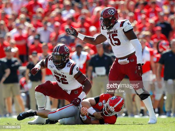 Kingsley Enagbare of the South Carolina Gamecocks reacts after sacking Jake Fromm of the Georgia Bulldogs in the first half with Aaron Sterling at...