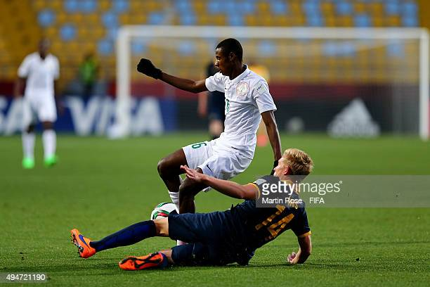 Kingsley Michael of Nigeria and Joshua Laws of Australia battle for the ball during the FIFA U-17 Men's World Cup 2015 round of 16 match between...