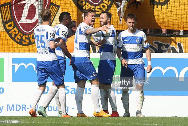 Kingsley Onuegbu of Duisburg jubilates with team mates after scoring the first goal during the third league match between SG Dynamo Dresden and MSV...
