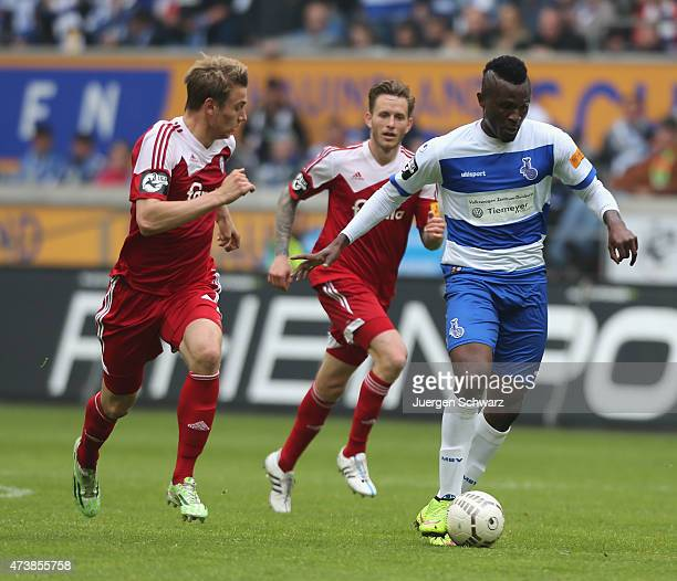 Kingsley Onuegbu of Duisburg passes the ball near Patrick Breitkreuz of Kiel during the 3rd Bundesliga match between MSV Duisburg and Holstein Kiel...