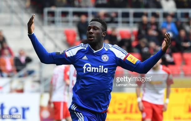 Kingsley Schindler of Holstein Kiel celebrates scoring the first goal during the 3 Liga match between Jahn Regensburg and Holstein Kiel on April 29...