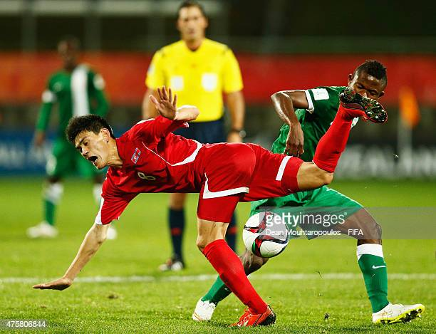 Kingsley Sokari of Nigeria and Ri Un Chol of Korea DPR battle for the ball during the FIFA U20 World Cup New Zealand 2015 Group E match between...