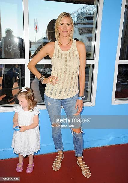 Kingsley Taekman and Kristen Taekman attend Elizabeth Glaser Pediatric AIDS Foundation's Kids 4 Kids Family Festival at Chelsea Piers Field House on...