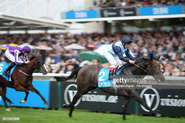 Kingston Hill ridden by jockey Andrea Atzeni wins the Autumn Stakes during the Dubai Future Champions Day at Newmarket Racecourse