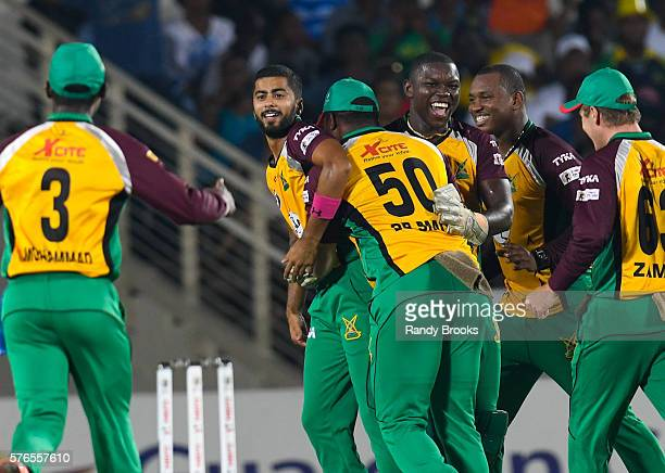 Kingston Jamaica 16 July 2016 Ali Khan Anthony Bramble and Christopher Barnwell of Guyana Amazon Warriors celebrate the dismissal of Kumar Sangakkara...