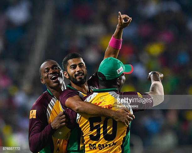 Kingston Jamaica 16 July 2016 Ali Khan Anthony Bramble and Dwayne Smith of Guyana Amazon Warriors celebrate the dismissal of Rovman Powell of Jamaica...