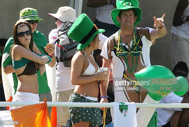 An Irish cricket fan takes her shirts off as others cheers for their team during the Group D match of the ICC World Cup Cricket 2007 between West...