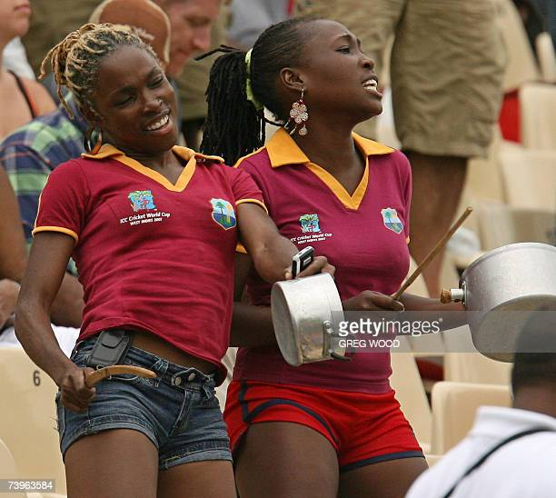 Cricket fans use pots and pans as drums as they watch Sri Lanka challenge New Zealand during the ICC Cricket World Cup 2007 semifinal match at the...
