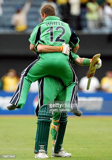 Irish cricket team captain Trent Johnston embraces teammate Andrew White as he celebrates after taking the last run to win over Pakistan during the...